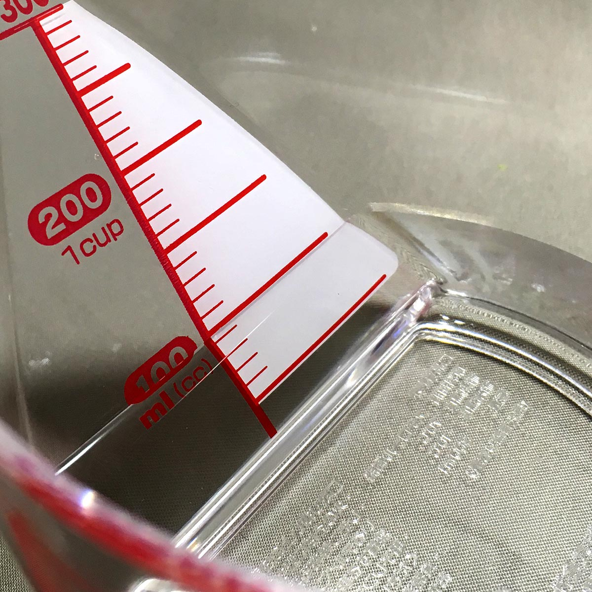Measuring Cup - 100ml water inside view