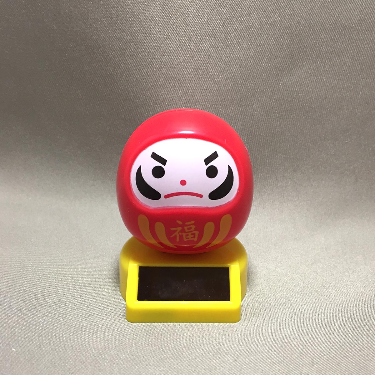 Solar Powered Swinging Daruma - Front