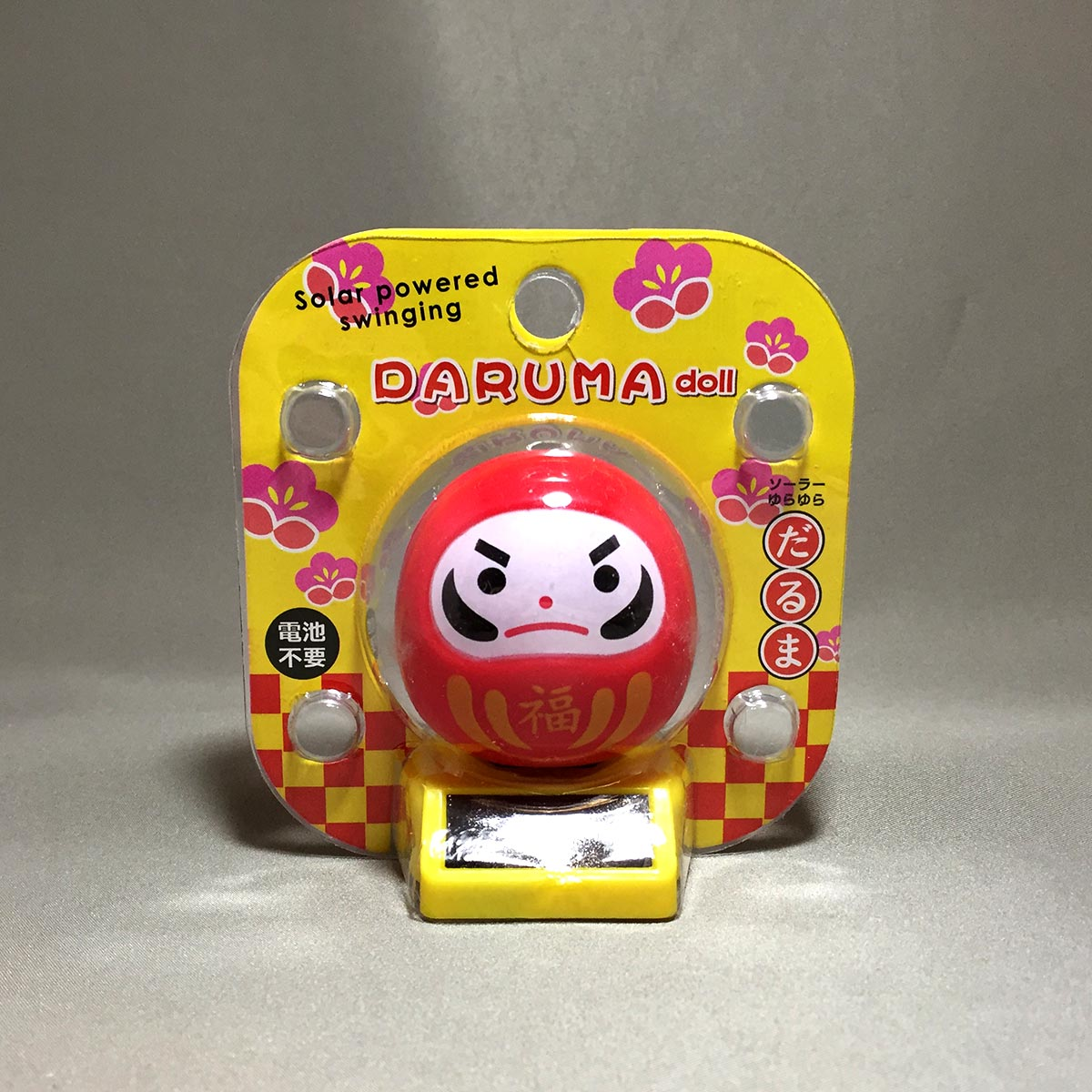 Solar Powered Swinging Daruma - Front packaging