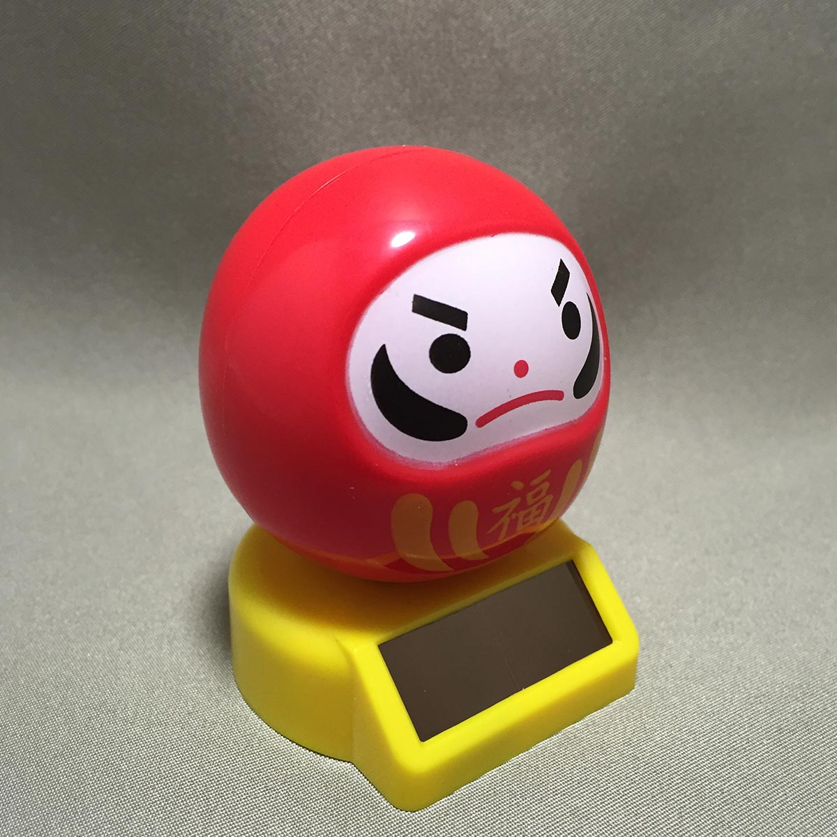 Solar Powered Swinging Daruma - Side