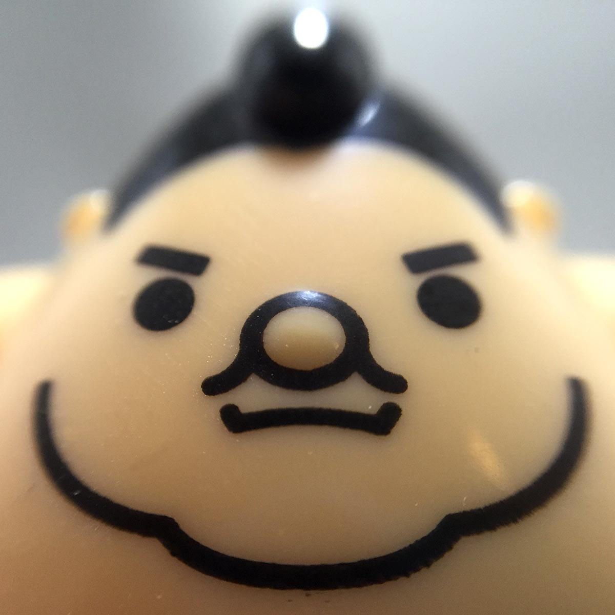 Solar Powered Swinging Sumo Wrestler - Macro face view