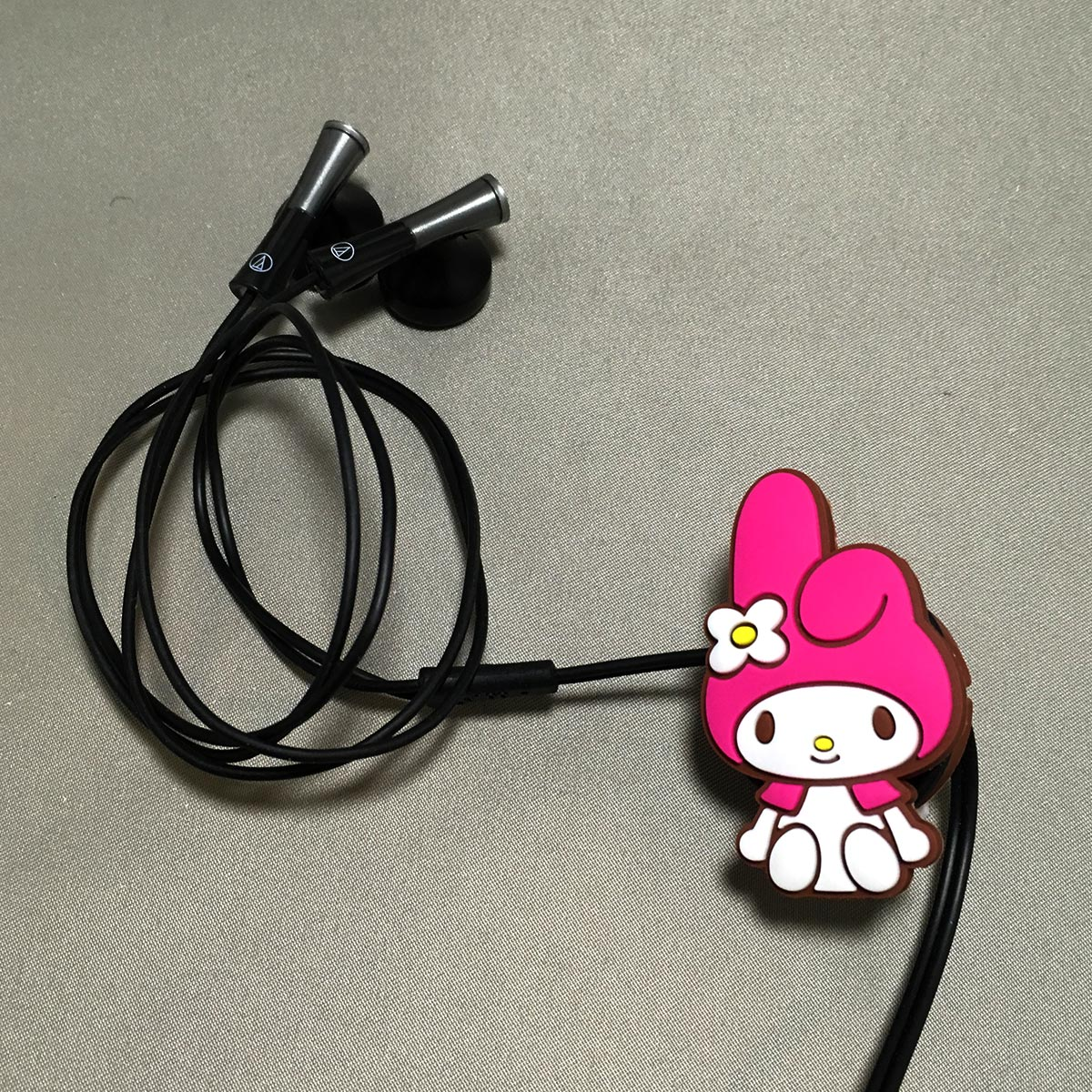 My Melody Cord Manager - wrapped earphones